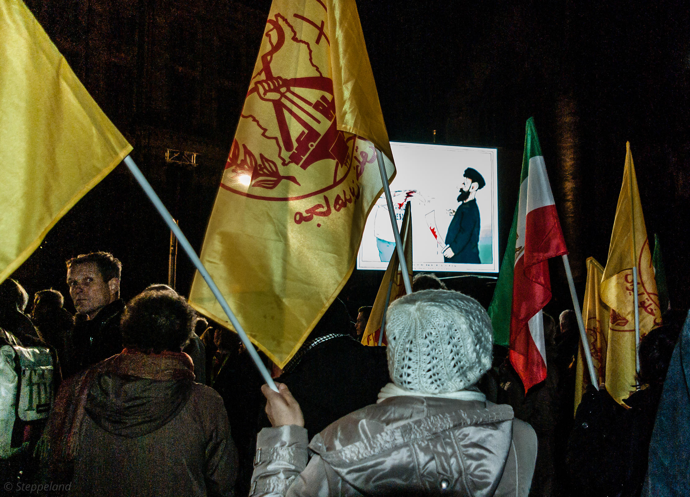 Amsterdam, Netherlands 2015-01-08: Flags and cartoons were carried during the demonstration : 'Je suis Charlie'.