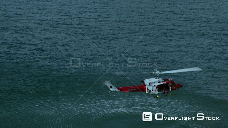 Aerial of a helicopter hovering above the ocean Cape Town Western Cape South Africa