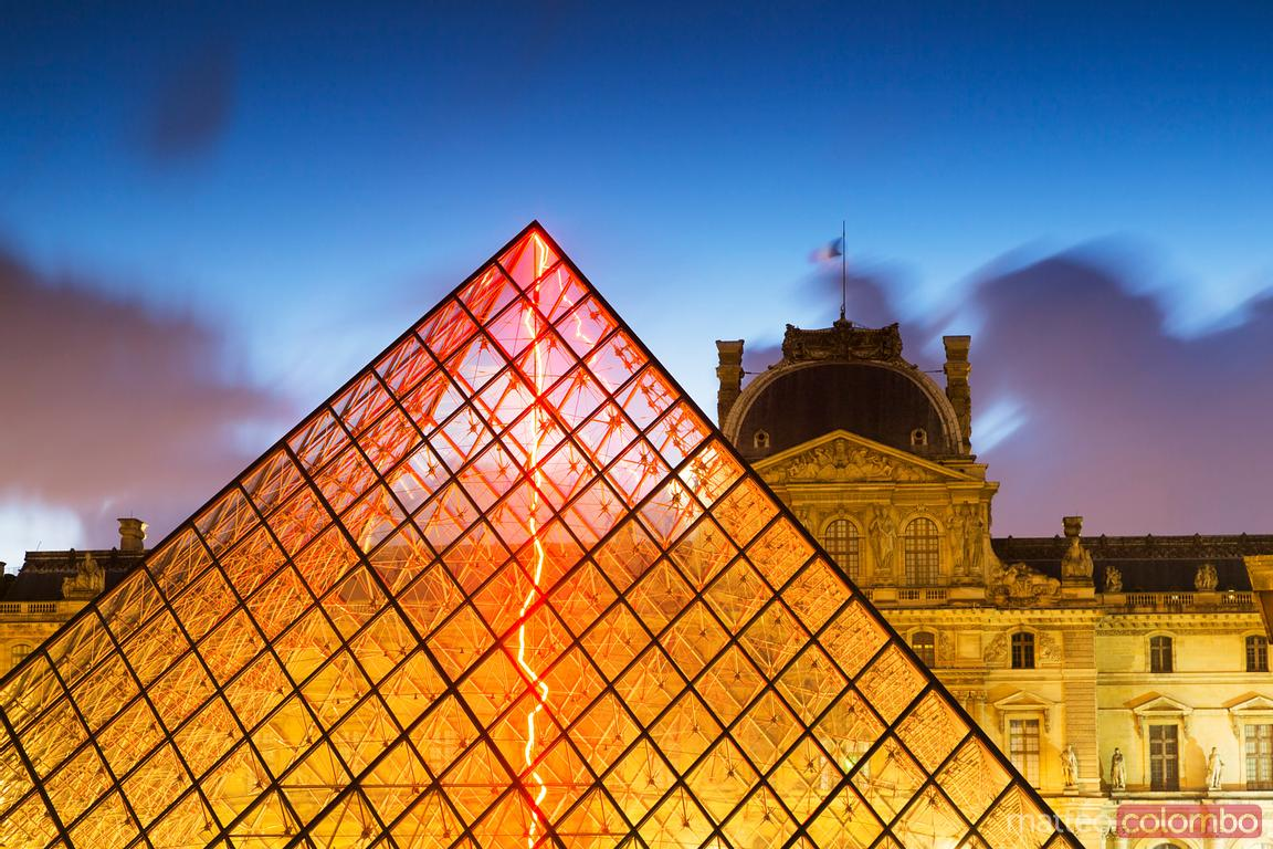 Louvre pyramid in front of the museum at night, Paris, France