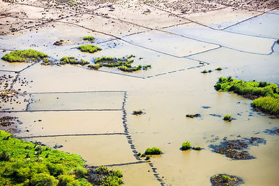 Aerial view of flooded farmland around Makhanga, which two months after the January 2015 floods, is still cut off after rail ...