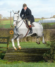 Graham Smith jumping a tiger trap - The Quorn Hunt at Woodpecker Farm
