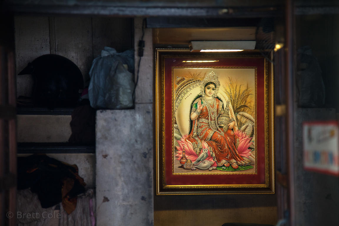 Painting of the Goddess Lakshmi hanging in a house in Shyambazar, Kolkata, India.