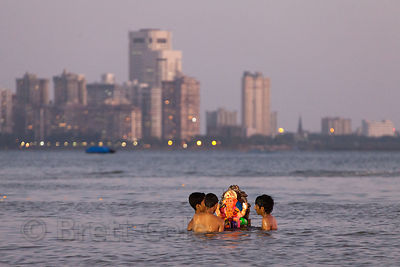 A group of men immerse their Ganesh Idol in the Arabian Sea during the Ganesh Chaturthi Festival, Mumbai, India.