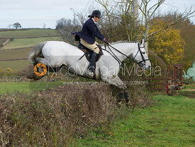 Liz Foster jumping a hedge at Town Farm