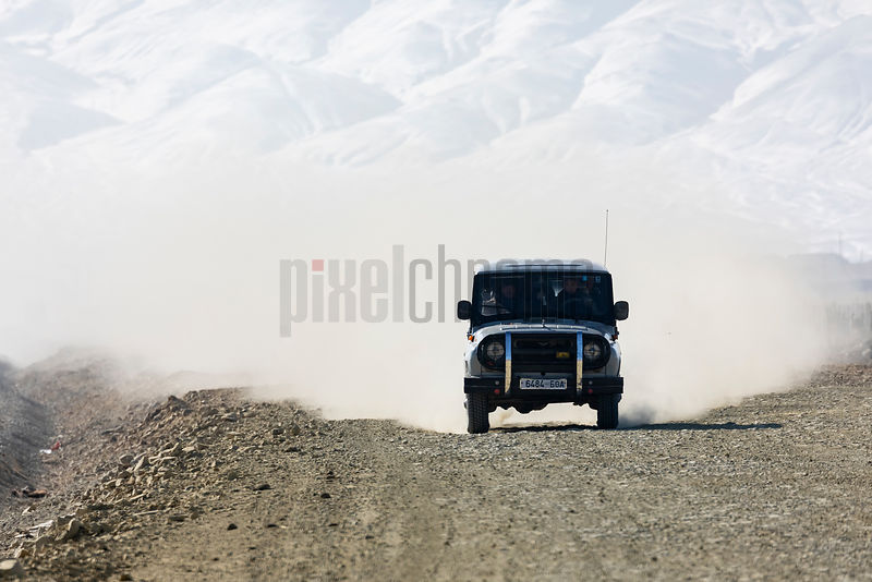 Old Russian Jeep Travelling on a Gravel Road