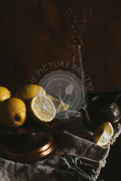 Still life of a tea cup, lemon slices and ginger on a rustic background, with copy space