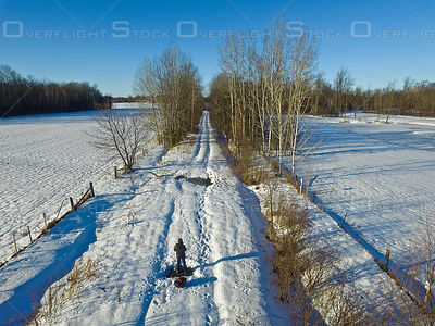 Drone Pilot on a Back Road in Winter Laurentians Quebec