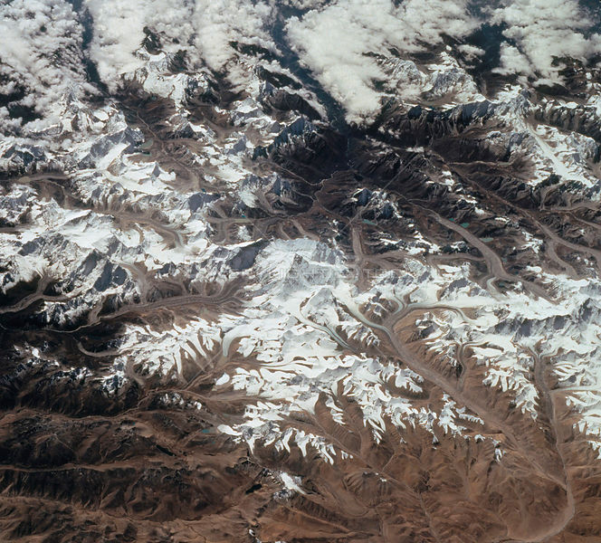 EARTH Nepal / Tibet -- 30 Sep-11 Oct 1994 -- This south-looking, summer-time view of Mt Everest (center)
