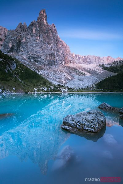 Alpine peak and lake lit by moonlight Dolomites Italy