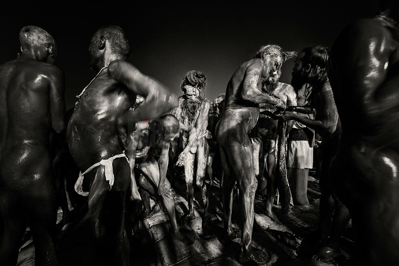 Naga Sadhus Applying Ash after the Dawn Holy Dip during Mauni Amavasya