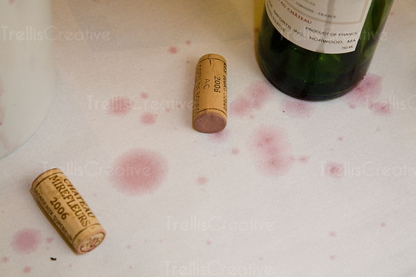 Wine drip stains a white table cloth