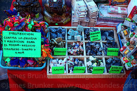 Box of various lucky charms for sale on stall, Alasitas festival, La Paz, Bolivia