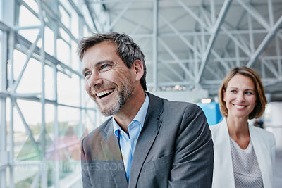 Happy businessman and businesswoman at the airport