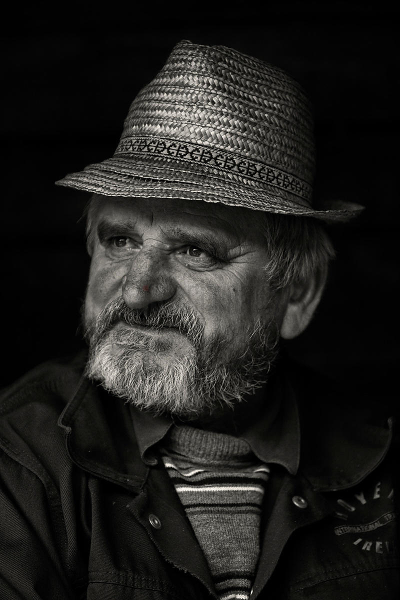Portrait of a Man in a Straw Hat