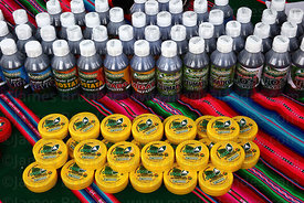 Creams for arthritis and bottles of various medicines on stall at trade fair promoting alternative products made from coca le...