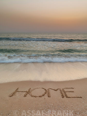Sand writing - Word Home written on beach