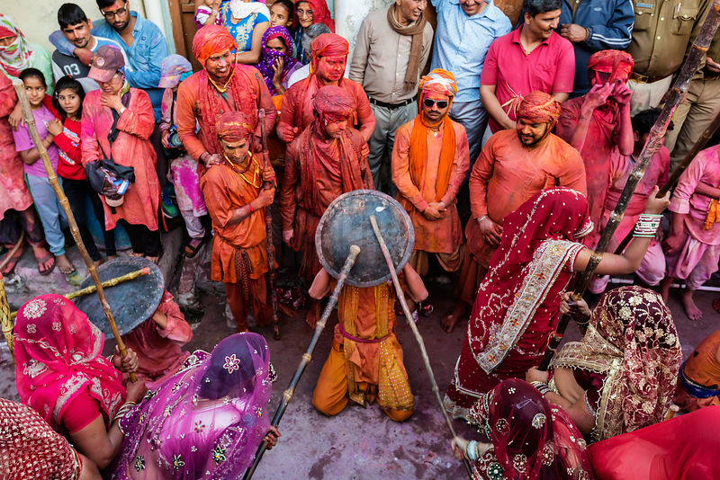 Gopis (Shepherdesses) of Nandgaon Beat the Gops (Shepherds) of Nandgaon with Long Sticks (Laths) During Lathmar Holi Celebrat...