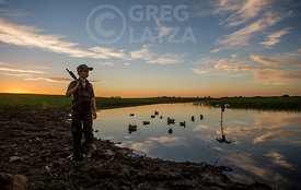 Young waterfowl hunter with decoys