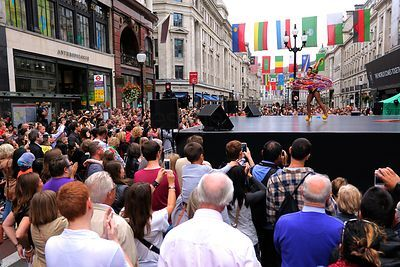 Hoola Hoop Performers on Stage in a Central London Street