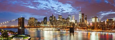 Panoramic of Brooklyn bridge and Manhattan skyline at night