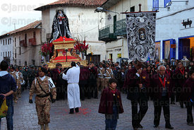 Devotees carry figure of Virgen Dolorosa during Good Friday procession , Cusco , Peru