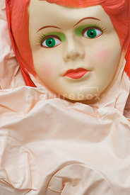 An image of the front of a deflated Blow-up doll.