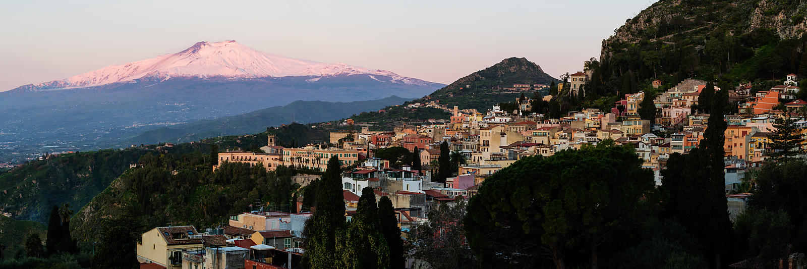 View of Mt Etna Looming up Behind the City of Taormina