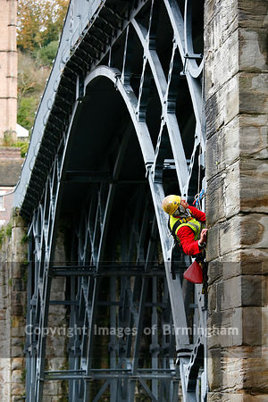 Surveyor inspecting the Iron bridge in Ironbridge, Telford, Shropshire.