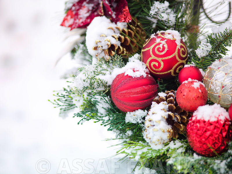 Christmas wreath with baubles in snow