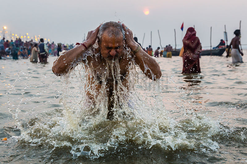Man Taking a Holy Dip at the Sangam on the Ganges River