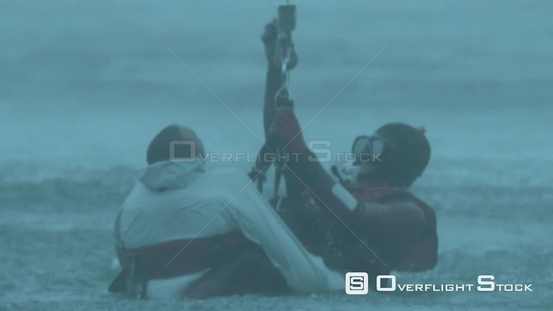 Aerial close up of two men being airlifted out of the sea Cape Town Western Cape South Africa