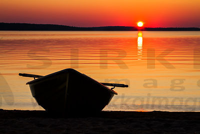 Rowing boat in sunset