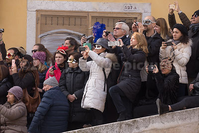 Spectators with camera phones