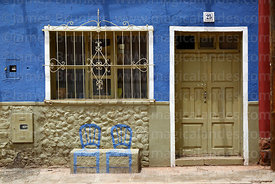 Seats painted on wall of house, Villa Abecia, Chuquisaca Department, Bolivia