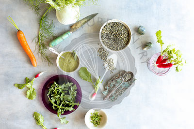 Green Lentil Salad Ingredients. Photographed on a light blue background.