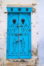 Another example of the blue door. This example is from the Mediana of Kairouan. Kairouan, Tunisia; Portrait