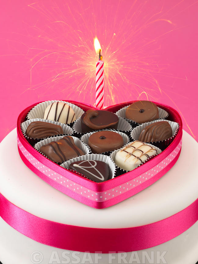 Heart shaped chocolate gift box with a candle