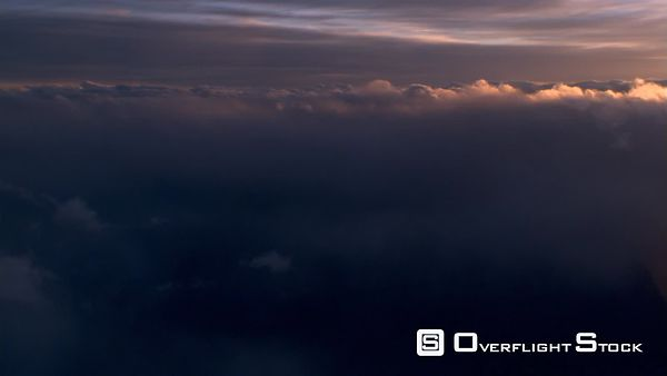 Slow evening flight through clouds, passenger POV