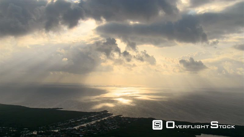Slow flight along Florida coastline near Miami, evening rays gleaming on water