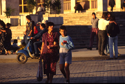 A mother and son shopping in central Tirana