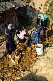 Hmong Women and Girls Washing Hair