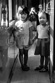 _W_P0366-Vietnam-two-little-girls-in-train