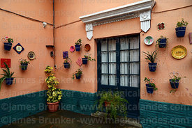 Ceramic tiles and pot plants in courtyard of Tasca Madrid restaurant, Tarija, Bolivia