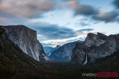 Sunset over valley and waterfall, Yosemite, USA