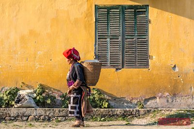 Woman from Red Dao tribe carrying basket, Sa Pa, Vietnam