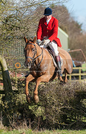 Ashley Bealby jumping the first hedge