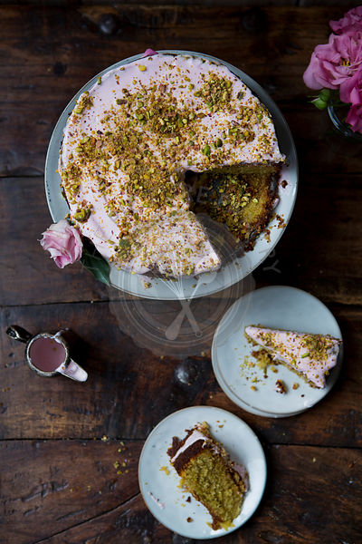 Pistachio and Rose Cake, Sliced to Serve with Jug of Icing