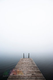 Austria, Mondsee, bathing jetty in morning mist