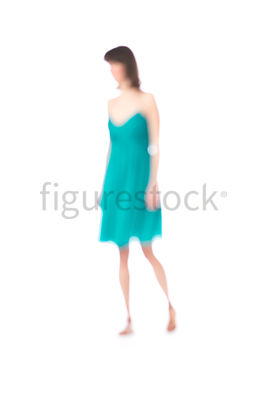 An abstract blurred figure of a woman in a teal dress – shot from mid level.