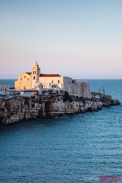 Sunset over old town of Vieste, Puglia, Italy